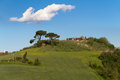 Tuscany farmhouse with cypress trees, Crete Senesi, Siena, Italy Stock Photography