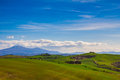 Tuscany landscape with typical farm house on a hill in Val d'Orcia Royalty Free Stock Photo