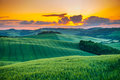 Tuscany, rural sunset landscape. Countryside farm, cypresses trees, Royalty Free Stock Photo