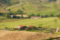Tuscanys hills in the evening light and old farmhouse tuscany italy Royalty Free Stock Image