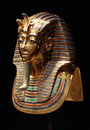 Tutankhamun s golden mask copy of pharaoh burial the popular icon for ancient egypt on the black background Stock Images