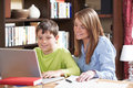 Tutor Helping Boy Studying At Home Royalty Free Stock Photo