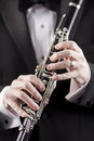 Tuxedo and clarinet hands of man in holding room for copy Royalty Free Stock Image