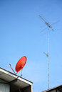 Tv antenna old style analog with new style disk Stock Photos