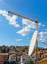 Tv antennas on buildings in the foreground as the concept of television broadcasts Royalty Free Stock Photo