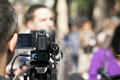 Tv broadcasting covering an event with a video camera Royalty Free Stock Images
