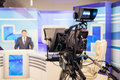 Tv camera recording male reporter or anchorman live broadcasting studio Stock Photo