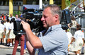 Tv news video operator working filming royal visit event in philipsburg st maartin november Stock Photos