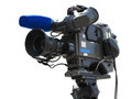 Tv professional studio digital video camera on tripod isolated o over white background Royalty Free Stock Images