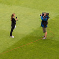 Tv reporter in live outside broadcast cameraman filming a young female sports during a from the friends life t finals day cricket Stock Photos