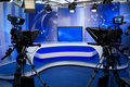 TV studio with camera and lights Royalty Free Stock Photo