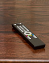 TV or television remote on table Royalty Free Stock Photo
