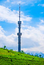 Tv tower almaty kazakhstan on koktobe hill against snow covered peaks of tien shan mountains Stock Photo