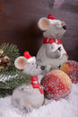 Tw mice in snow with sugar apples two friendly alone apple fir branch before a dark colored wooden background Stock Image