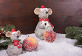 Tw mice in snow with sugar apples two friendly alone apple fir branch before a dark colored wooden background landscape format Stock Photography