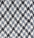 Tweed fabric houndstooth texture wool pattern close up Stock Image