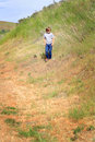 Tween boy exploring a preteen country walking in a field of tall grass shallow depth of field copy space Stock Photos
