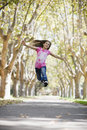 Tween Girl Jumping Stock Images