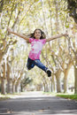 Tween Girl Jumping Stock Photography