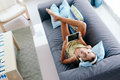 Tween girl relaxing on couch at home Royalty Free Stock Photo