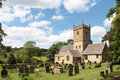 Twelfth century Chruch in Cotswolds village of Stock Photo