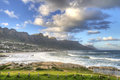 Twelve apostles mountain range and camps bay sout is an affluent suburb of cape town south africa in summer it attracts a large Stock Image