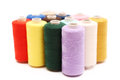 Twelve spools of thread multi coloured Royalty Free Stock Photography