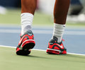 Twelve times grand slam champion rafael nadal wears custom nike tennis shoes during practice for us open flushing ny august at Royalty Free Stock Photo