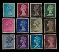 Twelve war time stamps from the s with the profile of queen elizabeth Royalty Free Stock Photos