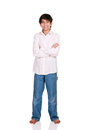 Twelve year old boy standing isolated arms crossed Stock Images