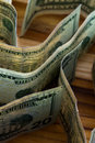 Twenty dollar bills close up of a few standing on their sides on a wooden table Royalty Free Stock Image