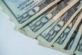 Twenty dollar bills laying on a white background Royalty Free Stock Photo