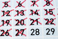 Twenty eighth day of this month detail view calendar page with seven strikethrough days in red black numbers over clear blue and Royalty Free Stock Photos