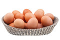 Twenty fresh chicken eggs in wicker basket isolated on white background Royalty Free Stock Image