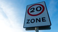 Twenty miles road sign zone against blue Stock Photography