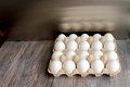 Twenty white eggs in cushion egg carton Royalty Free Stock Photo