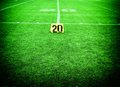 Twenty yards live lens marker on american football field Stock Images