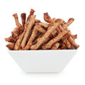 Twiglets twiglet savoury beef snacks in a porcelain square dish over white background Royalty Free Stock Photography