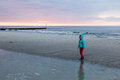 Twilight on a beach walking the in kolobrzeg between sunset and Royalty Free Stock Photo