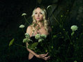 Twilight portrait of beautiful lady young with bouquet flowers Stock Photo