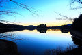 Twilight reflection in a lake blue and white color lake and tree Royalty Free Stock Photos