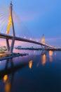 Twilight of suspension bridge bhumibol bridge with street light reflect in river bangkok thailand Royalty Free Stock Images