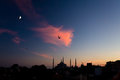 Twilight urban View of historical District of Istanbul City with Sea Gulls Royalty Free Stock Photo