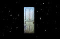 Twilight Zone Old Door in Space Royalty Free Stock Photo