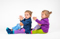 Twin babies and dolls with playing laughing Stock Photo