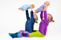 Twin babies playing with dols dolls and laughing Royalty Free Stock Images