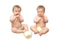 Twin baby girls are eating Royalty Free Stock Images