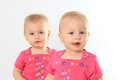 Twin baby girls one year old identical focus on the front girl Royalty Free Stock Photos