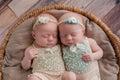 Twin Baby Girls Sleeping in a Wicker Basket Royalty Free Stock Photo
