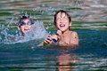 Picture : Twin boys play in the water tent high